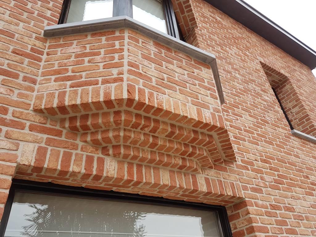 Wakken na renovatie met steenstrips detail